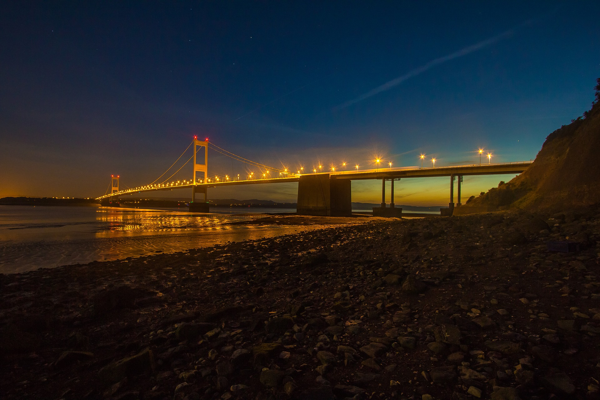 Iconic image of attractive Welsh Severn bridge lit up at night