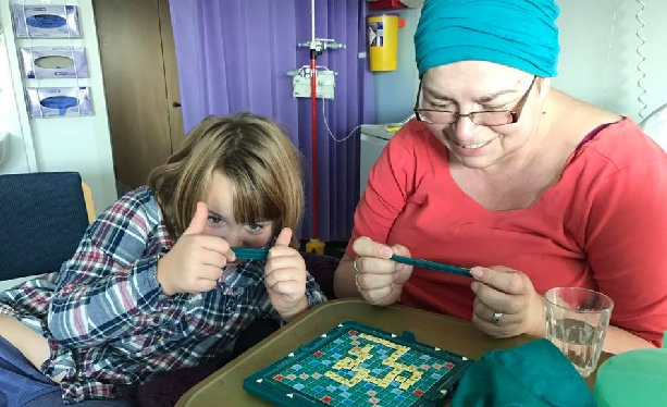 Katherine and her daughter playing Scrabble in the hospital