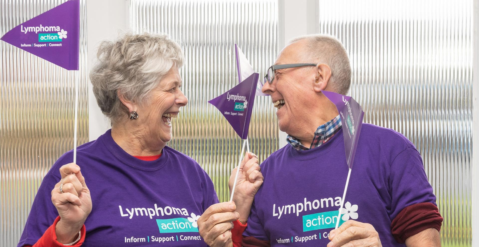 Female & male with Lymphoma Action flags