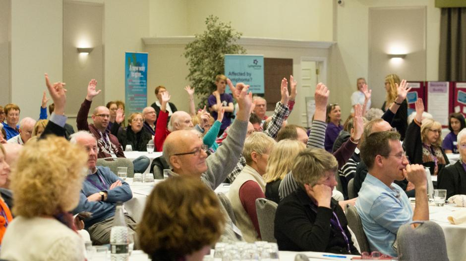 National.Conference.Crowd.Raising.Hands