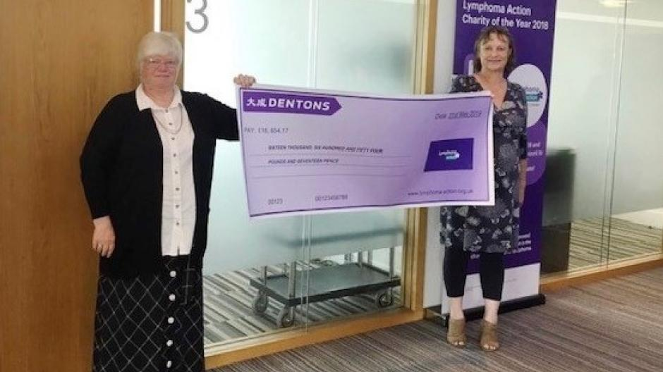 Adele & Sarah with large cheque from Dentons