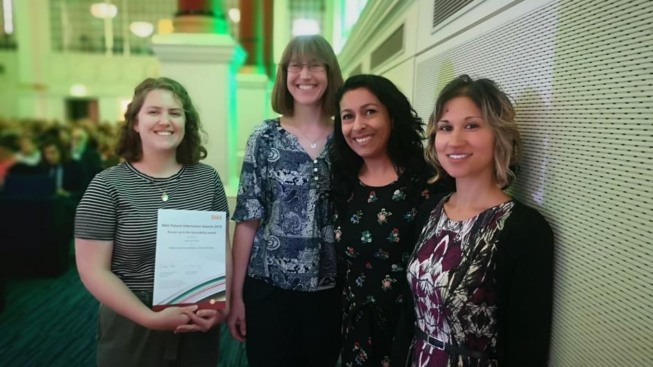 Publications Team with one of their awards
