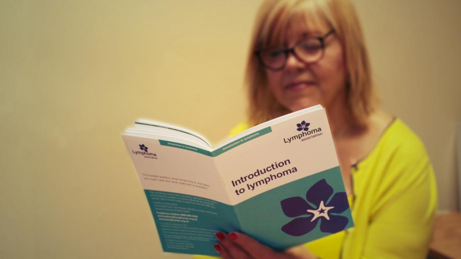 Lady reading Introduction to lymphoma booklet