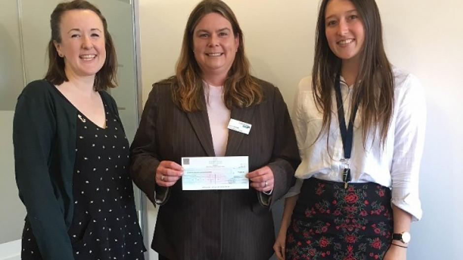 Chiara and her colleagues presenting a cheque to Lymphoma Action's Lucie Howells.